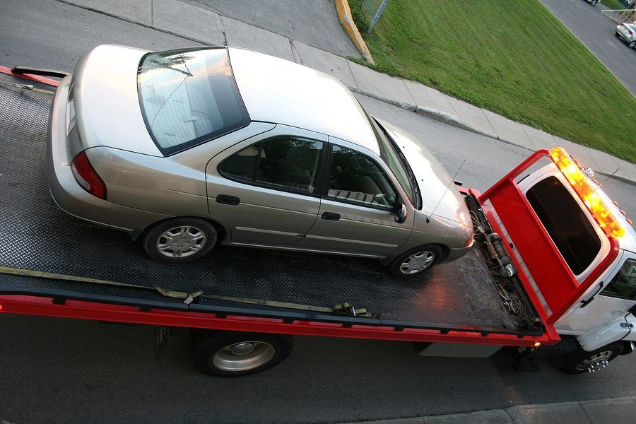 towing truck with a white car they just towed